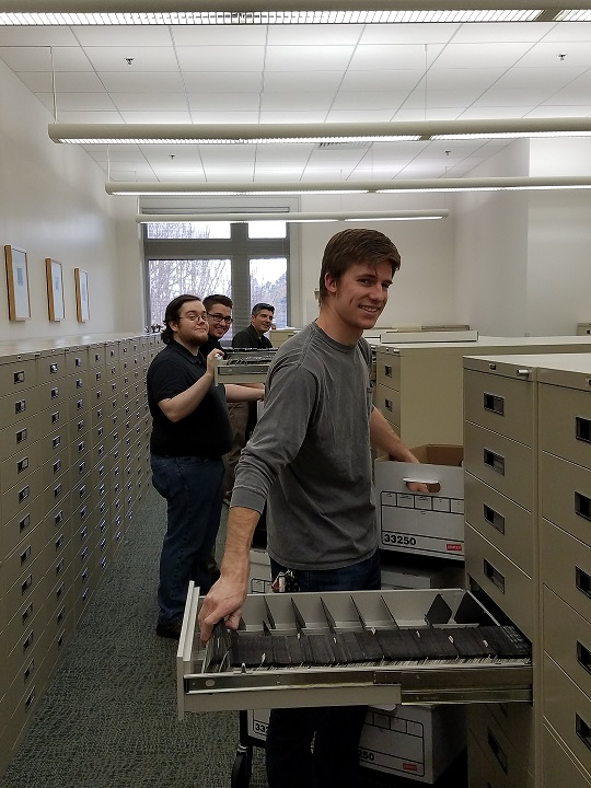 Marcus McCormick, Mason Sims, Slade Dupuy, and Brent Etzel share the task of emptying ERIC cabinets of over 509,000 sheets of microfiche.