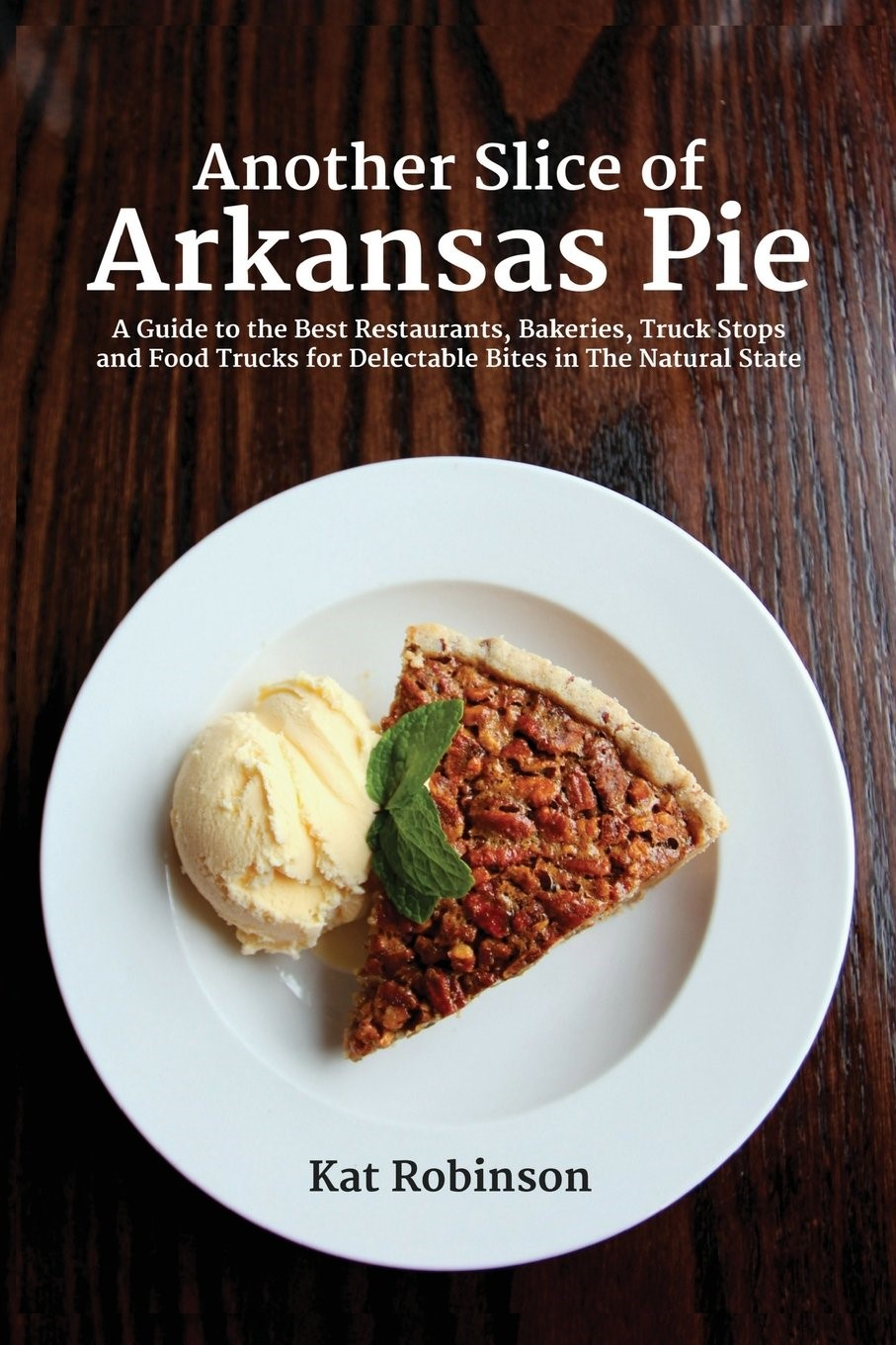 "Cover of Kat Robinson's book, ""Another Slice of Arkansas Pie"" featuring a plate of pecan pie and a scoop of vanilla ice cream"
