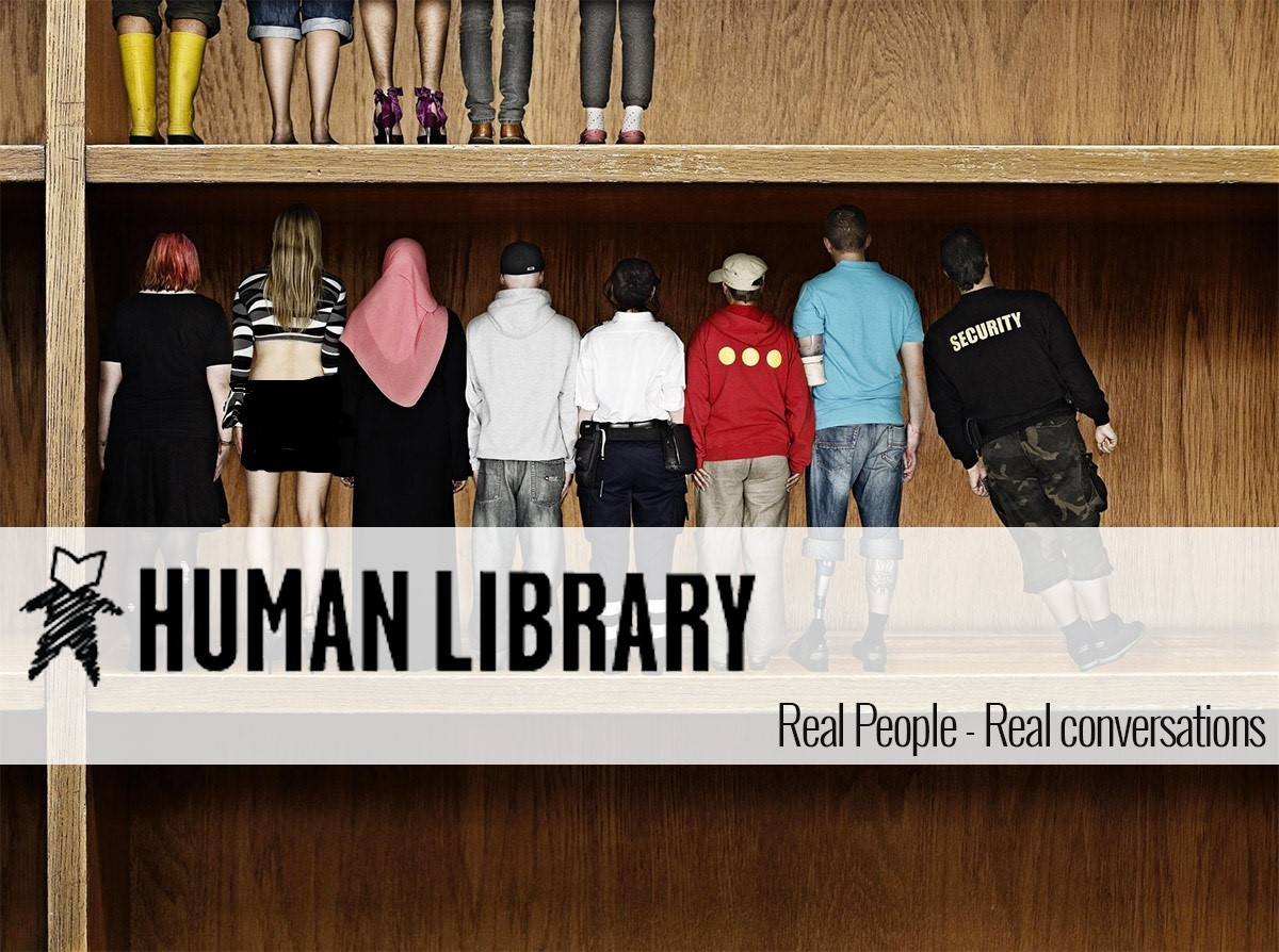 A photograph advertising the Human Library--pictures of people on a book shelf.